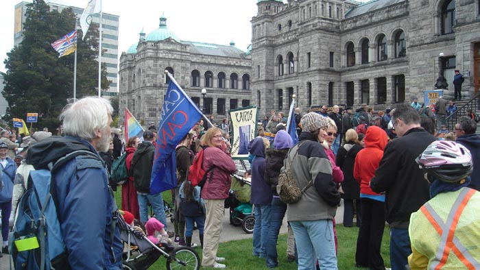 Sarah Dutsch (with CAW Flag) at Earth Day Rally in Victoria